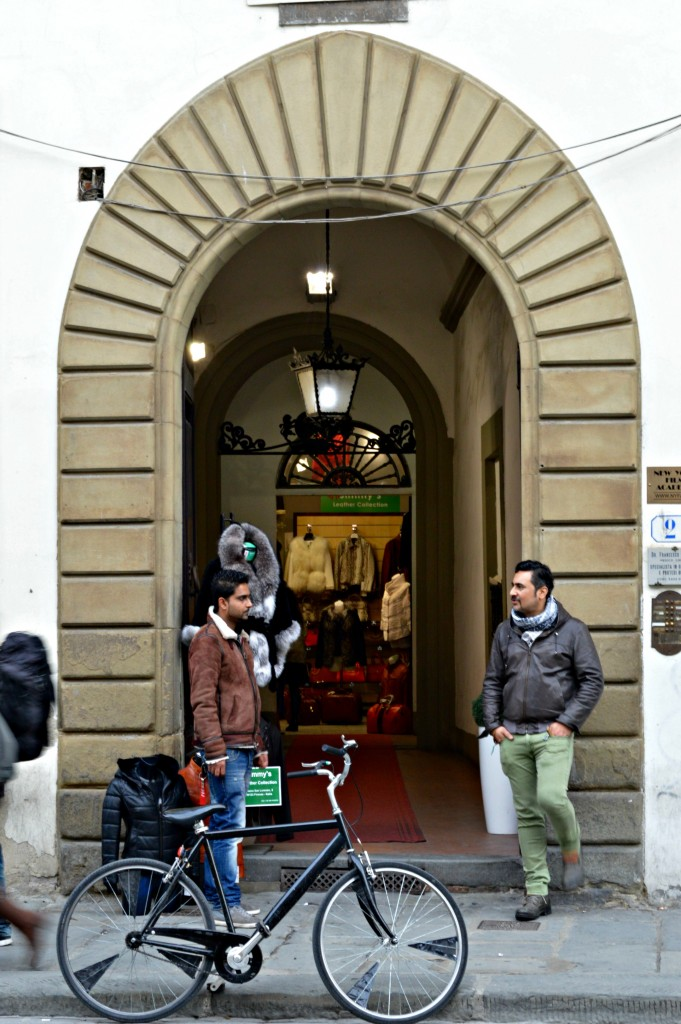 Leather sellers in doorway in Florence Italy