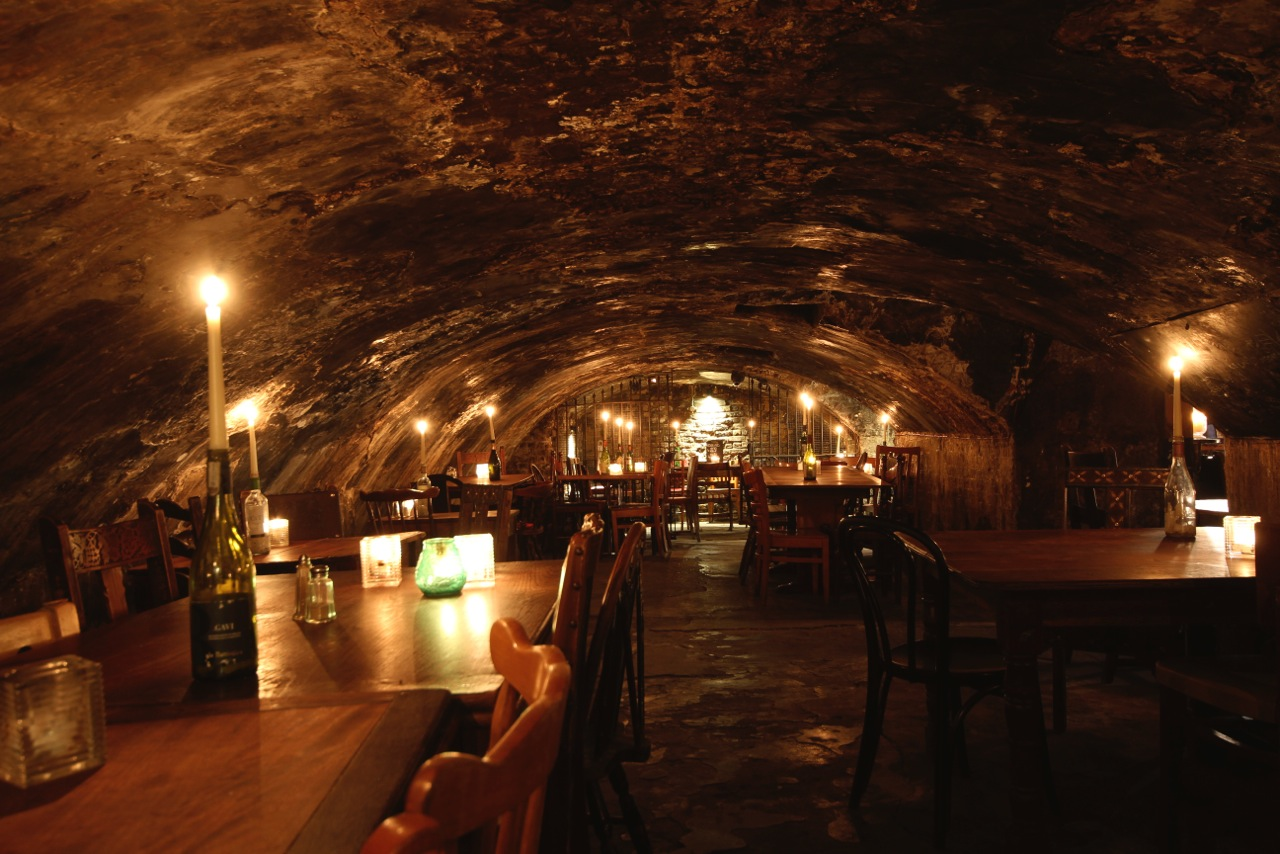 Romantic Things to do in London -- have a glass of vino in Gordons Wine Bar, in their dark and cosy caves. A unique and romantic thing to do in London for Valentine's day or a special occasion