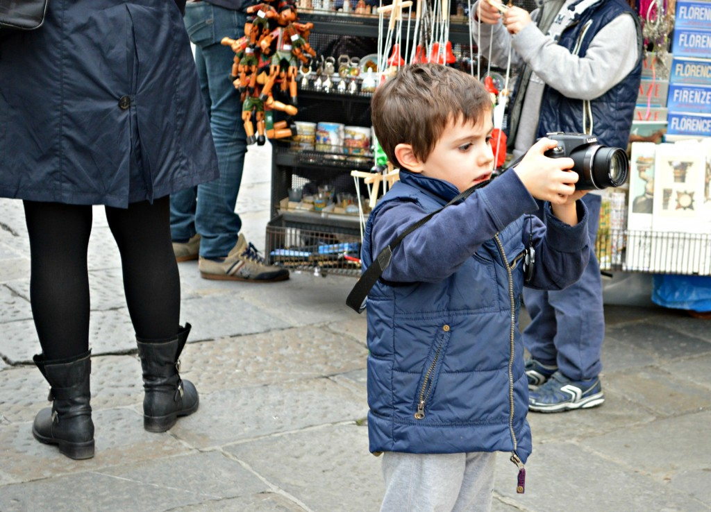 kid with camera in florence