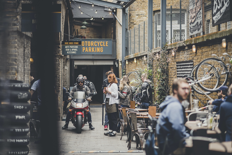 The Bike Shed is a motorcycle shop, restaurant, cafe, and barbershop all rolled into one venue under four Victorian railway arches.